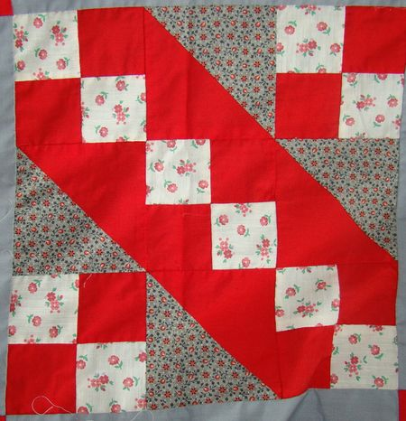 Red quilt closeup of block