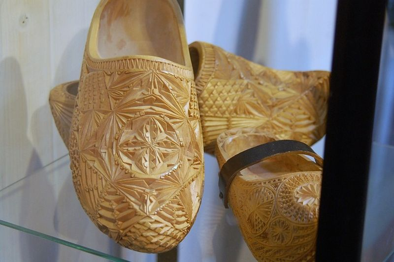 Intricate wooden clogs plain